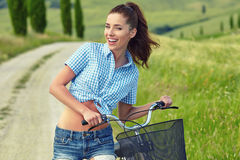 Beautiful girl with vintage bike outdoor, Tuscany summer time Stock Image