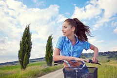 Beautiful girl with vintage bike outdoor, Tuscany summer time Royalty Free Stock Photography