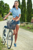 Beautiful girl with vintage bike outdoor, Tuscany summer time Stock Photos
