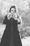 Beautiful girl with vintage camera in hand Stock Photo