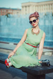 Beautiful girl in vintage clothing with retro camera Stock Photography