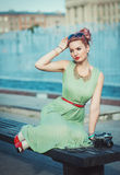 Beautiful girl in vintage clothing with retro camera Royalty Free Stock Photo