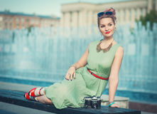 Beautiful girl in vintage clothing with retro camera Stock Photo