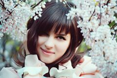 Beautiful girl in a vintage dress. Spring flowers. Lolita style. Victorian style. Beautiful girl in a vintage dress. Spring flowers. Victorian style royalty free stock photos