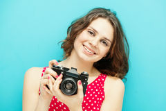 Beautiful girl with vintage photo camera Stock Images