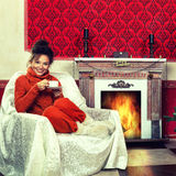 Beautiful girl in vintage room whit a cup of coffee and christma Stock Image