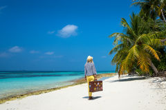 Beautiful girl with a vintage suitcase in a beach Royalty Free Stock Photography