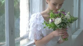 Beautiful girl in vintage white dress sitting on stock video