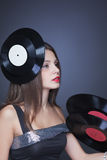 Beautiful girl with vinyl disc on black background Royalty Free Stock Images