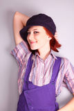 Beautiful girl in violet coverall Stock Images