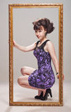Beautiful girl in a violet dress Royalty Free Stock Photo