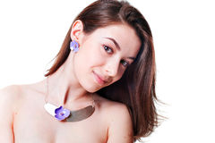 Beautiful girl with violet flower bijouterie Royalty Free Stock Photos