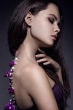 Beautiful girl with violet flowers. Royalty Free Stock Photos
