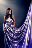 Girl in violet long dress Royalty Free Stock Photography