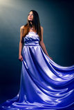 Beautiful girl in violet long dress Stock Photography