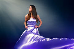 Beautiful girl in violet long dress Royalty Free Stock Photos