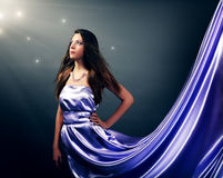 Beautiful girl in violet long dress Royalty Free Stock Photo