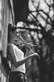 Beautiful girl with a violin in his hands Stock Image