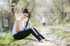 Beautiful girl with a violin in his hands Royalty Free Stock Photos