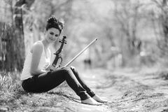 Beautiful girl with a violin in his hands Stock Photos