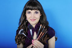 Beautiful girl visagiste with tassel for make-up with long hair Stock Photography