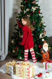 Beautiful girl is waiting Christmas and New year Stock Image