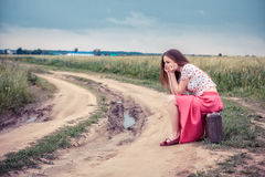 Beautiful girl waiting on a country road Stock Photography