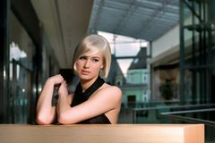 Beautiful girl waiting in a shopping center Stock Image