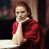 Beautiful girl waiting at a table in a cafe Royalty Free Stock Photos