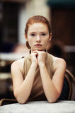 Beautiful girl waiting at a table in a cafe Royalty Free Stock Photo