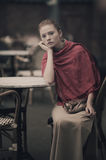 Beautiful girl waiting at table in cafe Stock Photo