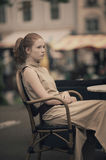 Beautiful girl waiting at table in cafe Stock Photos