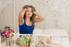 Beautiful girl wakes up in the morning. In bed Stock Photo