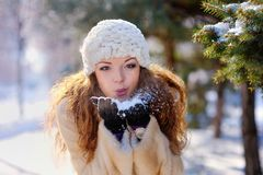 Beautiful girl on a walk in the park in winter Stock Photo