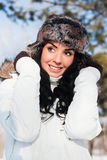 Beautiful girl on a walk in a winter park, Royalty Free Stock Photo