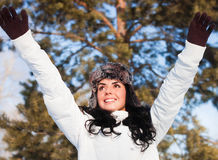 Beautiful girl on a walk in a winter park, Royalty Free Stock Photography