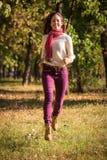 Beautiful girl walking on autumn park royalty free stock photos