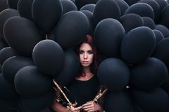Beautiful girl walking with black balloons Royalty Free Stock Image