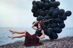 Beautiful girl walking with black balloons Royalty Free Stock Photography
