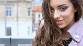 Beautiful girl walking in the coats on the street. 1 stock footage