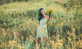Beautiful girl walking on flower meadow Stock Photography