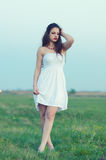 Beautiful girl walking on the meadow Stock Images
