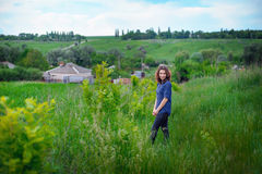 Beautiful girl walking in nature summer Stock Photo