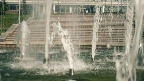 Beautiful girl is walking near the fountain stock video