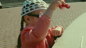 Beautiful girl is walking near the fountain stock video footage