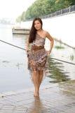 Beautiful girl walking near river Royalty Free Stock Photo