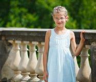 Beautiful girl walking in a park Stock Photos