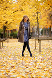 Beautiful girl walking in park on a fall day Royalty Free Stock Photo