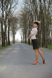 Beautiful girl walking on a road Royalty Free Stock Image