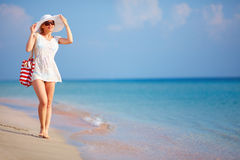 Beautiful girl walking the summer beach Royalty Free Stock Image